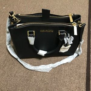 Black Michael Kors handbag. Médium